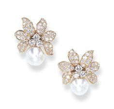 A PAIR OF DIAMOND AND CULTURED PEARL EAR CLIPS, BY VAN CLEEF & ARPELS Each designed as a flowerhead, with circular-cut diamond undulating petals and a circular-cut diamond cluster pistil, surmounting a drop-shaped cultured pearl, measuring approximately 10.90 x 12.30 mm, mounted in 18k gold, with French assay marks and maker's marks, in a Van Cleef & Arpels beige suede case Signed Van Cleef & Arpels, no. M34780
