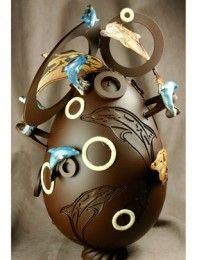 We can't get our heads around this Easter egg. It's a 3D extravaganza decorated with chocolate dolphins and chocolate hoops - we wish we could have a taste!Found on chicagomoldschool.com (image found on Pinterest)