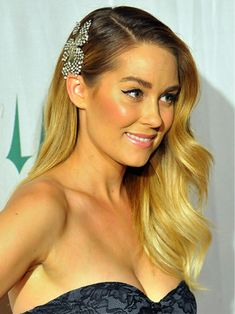 Ignoring the hair colouring, I like this idea of one side clipped back for bridesmaids if we are having fancy dresses