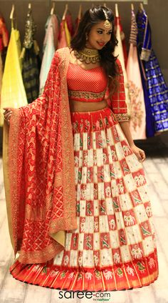 Cream and red patola print silk lehenga choli with bandhej dupatta Lehenga Saree Design, Half Saree Lehenga, Lehenga Designs, Silk Lehenga, Rajasthani Lehenga, Indian Bridal Lehenga, Indian Bridal Outfits, Indian Dresses, Choli Designs