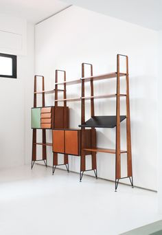 Anonymous; Teak, Iron and Brass Wall Unit, 1950s.