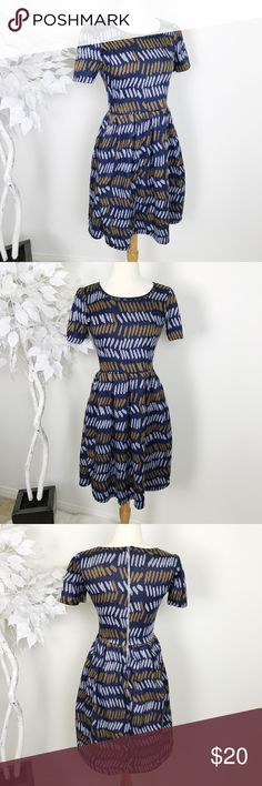 LuLaroe Amelia Pattern Dress👗💙 Lularoe Amelia Pattern Dress👗💙 Condition: EUC Size: S Very classy & and gorgeous dress. Worn once for a friends birthday. Dress zips from the back and features side pockets. *Please note* dress does have one small flaw of a knick/small hole located by neckline. No stains and no peeling. Dress has been washed once and hung to dry. Grab this beauty quick.   In Bin: GH **Comes from a SMOKE FREE 🏡 Home** LuLaRoe Dresses