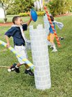 Great use for our huge cardboard tubes- cover in brick paper (or paint) for our Jousting tournament