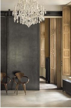 Love the chandelier, charcoal walls and wooden shutters