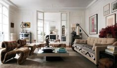 """The Chloé designer has created an inviting and eclectically decorated home within a cavernous, Haussmannian space in Paris's 16th arrondissement. """"I don't think I'll ever live in something this size again,"""" the designer told WSJ. Magazine."""