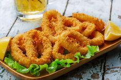 Squid, also called calamari, is one of the types of seafood with the lowest levels of mercury contamination, making it a potentially healthy choice. It's also an environmentally friendly seafood option. Low Fat Cooking, Cooking Tips, Empanadas, My Favorite Food, Favorite Recipes, Calamari Recipes, Fried Calamari, Portuguese Recipes, Onion Rings