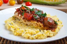 Chicken with cherry tomato pan sauce on fresh corn and basil polenta.
