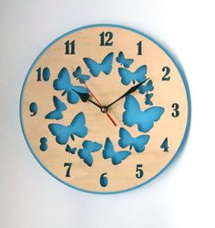 The blue wall clock with butterflies is made from high quality birch plywood and acrylic glass. It is wonderful gift for mother on Mothers Day or for