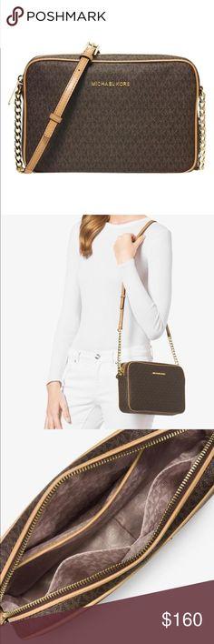 "Michael Kors Michael Kors Monogram Jet Set Travel cross body bag. Coated canvas with leather detailing. Adjustable strap 21""-24""   3 interior slip pockets. Gold hardware  zip closure   10""x 7"" x 2"" Michael Kors Bags Crossbody Bags"