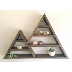 This geometric shelf can serve as a unique crystal/jewelry display or shadow box.    Measurements: height 20in x base width 30in x depth 3.5in