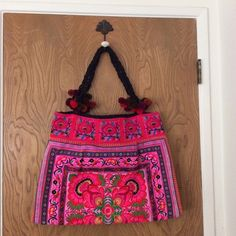 Hmong embroidered shoulder bag Embroidered bag, fabric handles, Pom Pom trim.  New without tags. Dimensions of bag are 21 inches wide by 15 inches length. NWOT. Bags