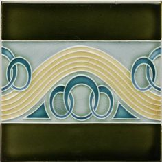 An Art Nouveau partial relief tile with stylised wave and ring design in pale yellow and light blue on a...