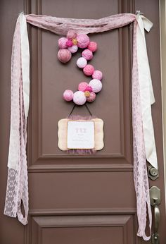 Easy DIY yarn ball door hanger for a birthday party