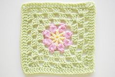 """Pattern: Square 53 from Leisure Arts 99 Granny Squares to Crochet Hook used: J Finished size: 7"""" Colors Used: Michael's Loops and Threads Impeccable Worsted in Soft Fern. Hobby Lobby's I love this yarn in Buttercup and Metallic Pinky Toes. A cute little flower square. I'm pretty sure this one..."""