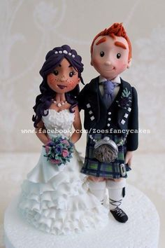 bride and groom topper by Zoe's Fancy Cakes - http://cakesdecor.com/cakes/216915-bride-and-groom-topper