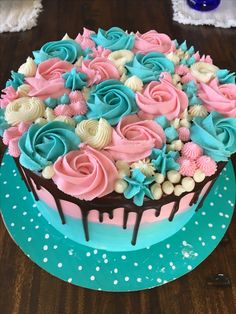Teal and pink drip cake