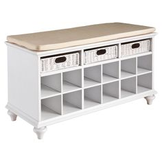 NORTHRUP STORAGE BENCH. Love this for front entrance with cubbies for shoes and baskets for hats, gloves, leash etc. I would recover the cushion though in a beautiful, colorful print