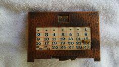 http://www.ebay.com.au/itm/Vintage-perpetual-calendar-hammered-copper-arts-and-crafts-mission-style-/172045554179?_trksid=p2047675.l2557