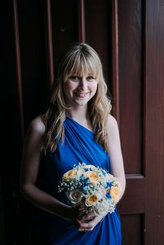 Buttercup rose, blue bee delphinium, pretty gypsophila and ice blue hydrangea bridesmaid bouquet