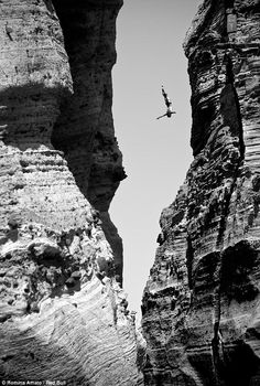 Extreme cliff diving at the Red Bull Cliff Diving Championship in Portugal. Photo by: Romina Amato