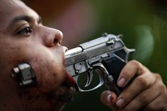 A devotee of Ban Tha Rua Chinese shrine with a gun pierced through his cheek takes a part in a procession celebrating the annual vegetarian festival in Phuket October 19, 2012. The festival celebrates the local Chinese community's belief that abstinence from meat and various stimulants during the ninth lunar month of the Chinese calendar will help them obtain good health and peace of mind.