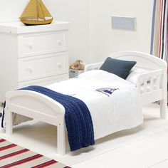 The Country Toddler Bed from East Coast has a simple, elegant look, with solid ends and gently curving top rails. It features side rails for additional security, to make your child's transition from cot to bed more comfortable for them. This will complement a traditionally styled room beautifully.