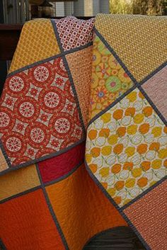 Love this idea! Each square is individually machine quilted with a different design and then the squares are joined using a quilt as you go method. The back of the quilt is just as pretty but all coordinating solids, which really highlight the quilting designs. Pretty and beautifully textured.