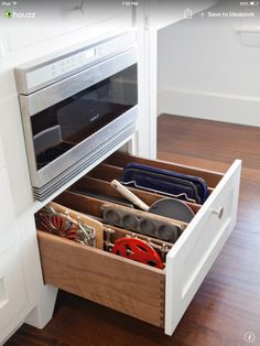I love the idea of a drawer like this to store some of the baking pans that are currently a mess