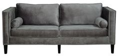 Cooper Grey Velvet SofaHandcrafted with over 1,300 hand-applied silver nail heads, the soft blue velvet Cooper sofa brings style and comfort to any space. This fashionable sofa boasts a kiln dried wood frame with birch wood legs and removable high density foam cushions, to provide maximum support and comfort for years of enjoyment.Dimensions84.06