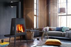Contemporary Fireplace Designs - This kind of modern wood design fireplace can help a homeowner add elegance to any room. The wood can be used in many Contemporary Fireplace Designs, Modern Fireplace, Living Room With Fireplace, Modern Wood Burning Stoves, Stove Fireplace, Family Room Design, Interior Design, Home Decor, Wood Heaters