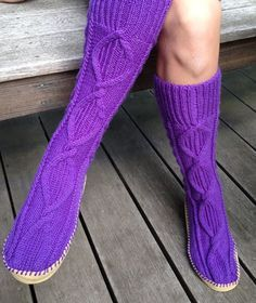 Free Knitting Pattern for Cabled Slipper Socks  These cozy calf-high slippers by Patons feature an elegant cable pattern. Sizes Small, Medium, Large, X-Large. Pictured project by bfleming24