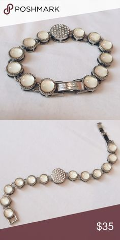 Lia Sophia bracelet This is a beautiful bracelet that dresses up anything from jeans to an elegant gown. It is in excellent condition and comes in a box. Lia Sophia Jewelry Bracelets