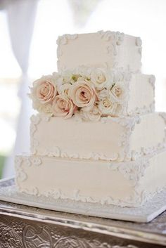 The Ultimate Wedding Cake Roundup: 100 Showstopping Sweets: Tradition meets style when it comes to this pretty off white square cake. Photo by Elyse Hall Photography via Style Me PrettySource From Showstopping Sweet wedding cake.