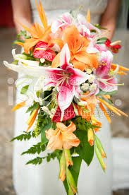 Tropical, colourful cascade with birds of paradise. I would change some f the Lys for Hibiscus and I'm ready to walk down the aisle