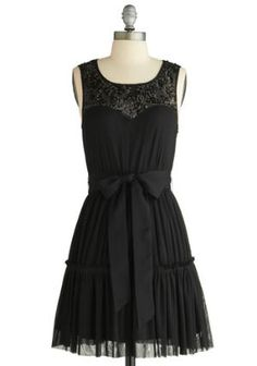 little black dress, I'm thinking with a red bow instead??