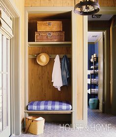 If you've got an unused closet or nook, transform it into a mini-mudroom by removing the door and adding a bench, shelf and peg-rail hooks.   Photographer: Tria Giovan   Designer: Morgan Michener