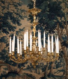Louis XV style large gilt bronze chandelier in front of an early 18th century Flemish tapestry