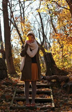 Big scarf, skirt, coat, shoes and best of all.... Leaves.