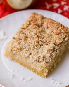 Gooey Coconut Butter Bars - a soft, delicious treat with creamy layers of cake and cream cheese and just the right amount of coconut. Coconut Bars, Vegetarian Cake, Brownie Bar, Cookie Desserts, Dessert Bars, Vanilla Cake, Baked Goods, Yummy Treats, Layers