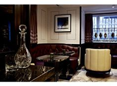 Located in the old luggage room of the Marriott Hotel in Grosvenor Square, this elegant cocktail lounge is part-speakeasy (in so much as the entrance is hidden away and you'll need to knock to gain entry), part stylish hotel bar. The interior is sleek, all polished marble, cream walls, soft leather and dark wood with nice art deco touches, while the atmosphere is a bit more laid back than you might expect for a five star venue - something we approve of – it's more friendly than fussy…