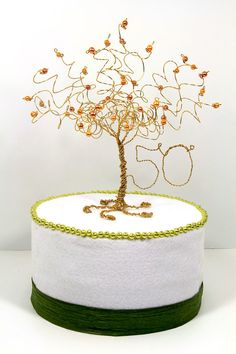 50th Anniversary Cake Topper Gold Tree Sculpture by NouveauTique ~ What could be more perfect for your golden anniversary cake than this gorgeous glowy golden pearl tree to symbolize how your love has grown over the years?