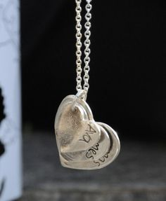 thetravellingsouk.com - A fine silver pendant with 3 fingerprints imprinted into the charms, and names hand written along side. The charms can be made in heart or teardrop shape.Due to the nature of the charms getting smaller in size the smallest size will only fit a maximum of 6 letters on it.This pendant comes on a sterling silver snake chain.Upon order we will despatch a print taking kit, which you can use to take the fingerprints, and return to us by post. Upon receipt of your prints…