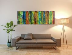 Elongated colorfield painting with earthy fall colors and iridescent drips for additional depth. This piece goes perfectly above a neutral couch or sofa. Mainly green tones with yellow, orange and ...