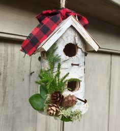 I've covered this wooden bird house with real Birch bark that I've collected from dead birch logs here in New Hampshire. I've decorated it with dried Princess Pine, Hemlock cones and a strip of Plaid