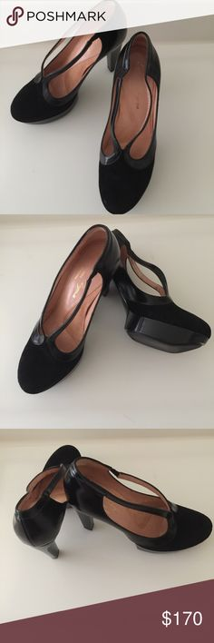 """Robert Clergerie Platform Pumps Stylish and chic Robert Clergerie Platform Pumps in excellent. These shoes have no sign of wear, no stains, spots or defects. In mint condition as it has never been worn, except tried on in store. Please take a look at pictures👁👁    Size:6.5  Platform:1""""  Heel:4""""  Color:Black Robert Clergerie Shoes Platforms"""