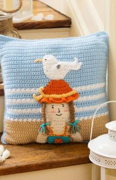 Bring happy beach memories inside. This adorable crochet By the Sea Pillow, a free Pattern, will bring a smile.