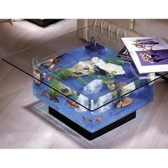 Midwest Tropical Aquarium Coffee Table combines the elegance of a coffee table and a functional design of an aquarium. Experience the wonder of the aquatic life from the top and the sides of this uniq