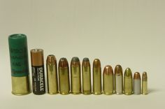 454 Casull, .45 Winchester Magnum, .44 Remington Magnum, .357 Magnum, .38 Special, .45 ACP, .38 Super, 9 mm Luger, .32 ACP, .22 LR (From battery to the right)