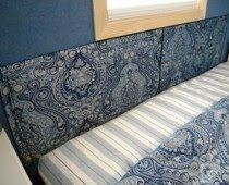 Realizing we had a large number of donated pillow shams, the idea of creating headboards out of pillow shams popped into my head.  Pillowsham Headboards – Flint Cottage Living Examiner.com Click the image for the full post. #homeless #shelter #makeover www.deservingdecor.org