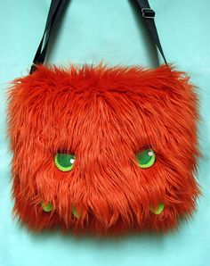 OMG SO FRIGGIN CUTE MONSTER BAG!!! I like ze orange one betterer